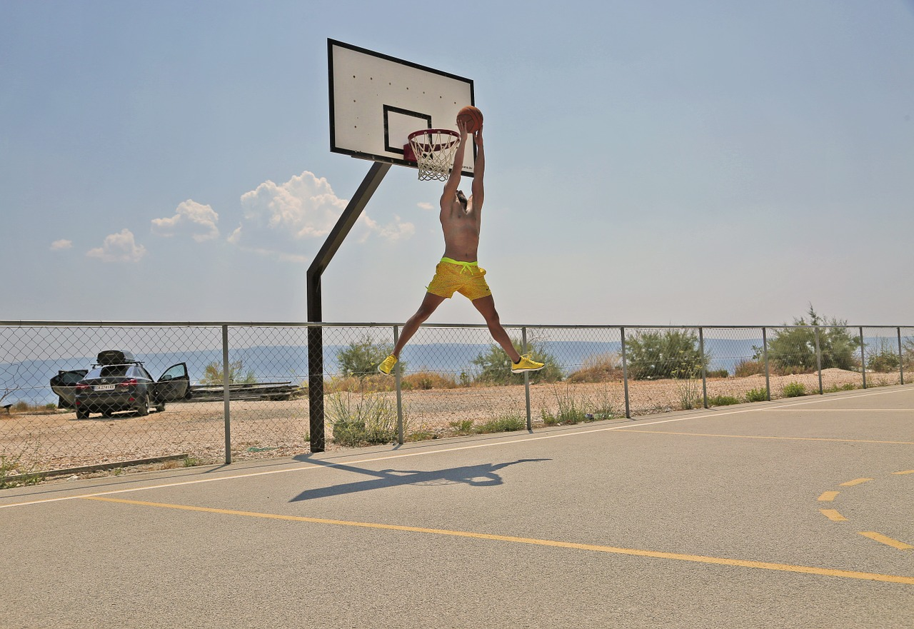man playing basketball in an outdoor court wearing the best outdoor basketball shoes